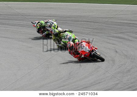 SEPANG, MALAYSIA- OCTOBER 22: 2011 MotoGP riders follow the slipstream of Nicky Hayden (69) during qualifying of the Shell Advance Malaysian Motorcycle GP 2011 on October 22, 2011 at Sepang, Malaysia.