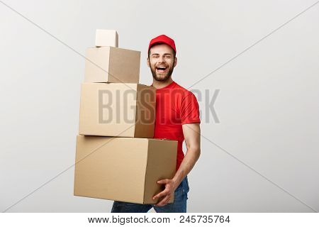 Delivery Concept: Man Hardly Carries The Cardboard Boxes, Isolated On White Background. Concept Of D