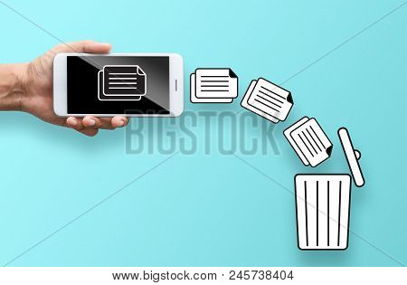 Business Hand Throw Data File From Mobile To Trash Bin