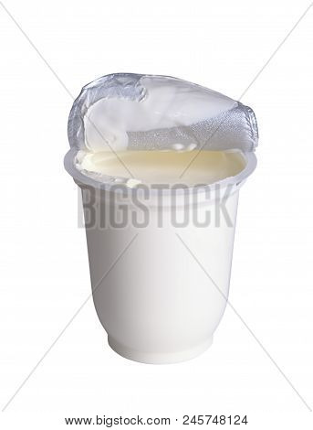 Fresh Sour Cream In A Plastic Container With An Open Cover, Isolated On White