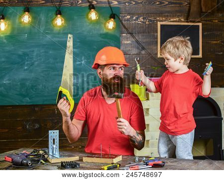 Fatherhood Concept. Boy, Child Cheerful Playing And Learning To Use Tools With Dad. Father, Parent W