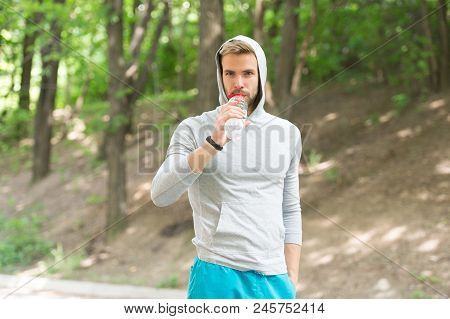 Sport And Healthy Lifestyle Concept. Man With Athletic Appearance Holds Bottle With Water. Man Athle
