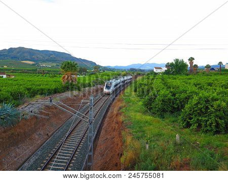 Alora, Spain - May 13, 2018: Malaga To Seville Train On Electric Track Near Alora Andalusia,