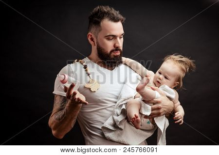 Adorable Caucasian One-year Old Baby With Funny Hairstyle, Refusing To Drink Water From Nursing Bott