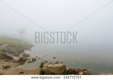 Misty morning by Lago Enol in the mountains of Picos de Europa, Asturias, Spain.