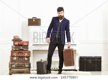 Man, Traveller With Beard And Mustache With Luggage, Luxury White Interior Background. Macho Elegant