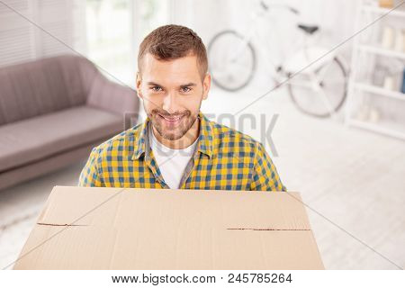 Time To Leave. Optimistic Vigorous Man Holding Box And Grinning To Camera