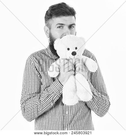 Kindness, Care And Tenderness Concept. Guy With Beard Hugs Soft Toy With Tenderness. Hipster Cares A