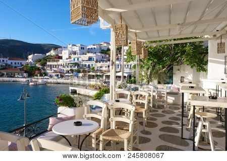 View from the seaside restaurant in picturesque village of Batsi on  Andros island, Cyclades, Greece
