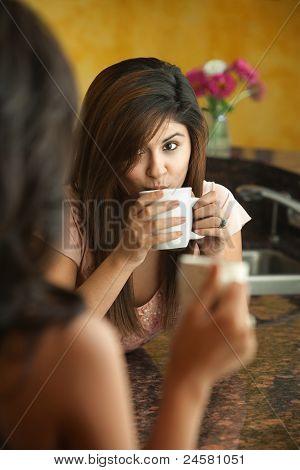 Woman Drinks From A Mug