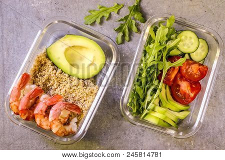 Healthy Meal Prep Containers With Quinoa, Shrimp, Arugula, Cucumber And Avocado