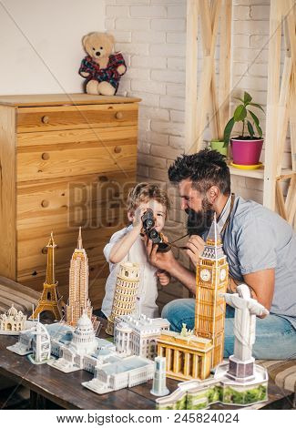 Choosing Traveling Point. Boy Son And Father With World Landmark Buildings In Miniature. Man And Lit