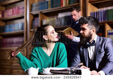 Literature Cafe With Bearded Man And Cute Girl. Couple In Library With Typewriter And Teapot Drinkin
