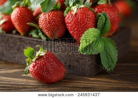 Fresh Juicy Strawberries With Leaves. Strawberry Background. Healthy Food Concept. Fresh Organic Ber