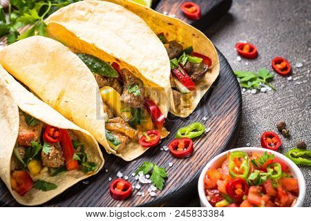 Tacos Food. Mexican Pork Tacos With Vegetables And Salsa. Traditional Latin American Food.