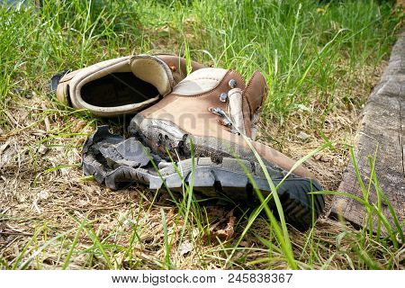 Broken Hiking Boots On A Hiking Trail In The Harz National Park In Germany
