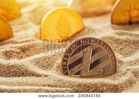 Silver Litecoin Coin In Sand, Conceptual Image For Lost And Found Valuable Cryptocurrency Coins That