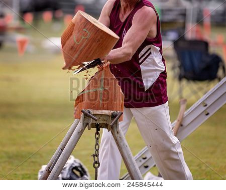 A Wood Chopper Competing N An Event At A Country Show