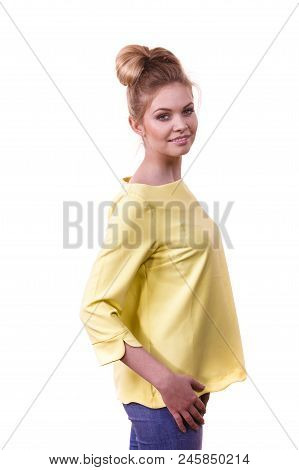 Adult Woman Presenting Her Casual Beautiful Outfit, Long Sleeved Yellow Top And Jeans.