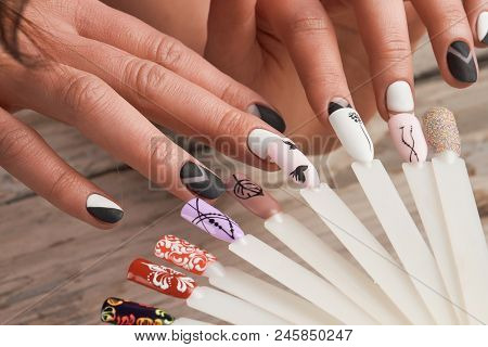 Nails Art Design Samples And Female Hands. Collection Of Finger Nails Painted In Various Color With