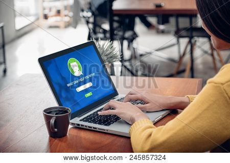 Asia Woman Ask Chat Bot Function In App On Laptop Screen Looking For Customer Support Online Shoppin