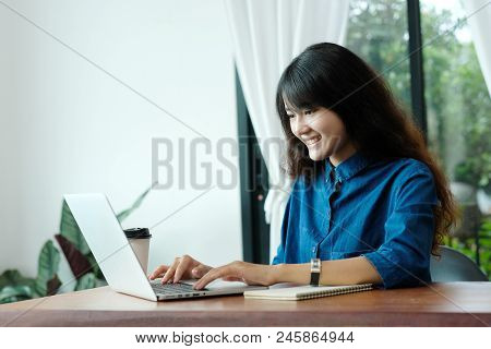 Young Asian Woman In Casual Style Using Laptop Computer In Room Background, People And Technology, W
