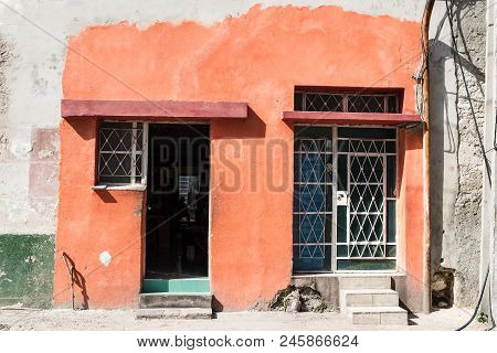 Cuban House Attempting To Look Fresh With A Coat Of Paint. Next Door Has Not Received As Much Care.