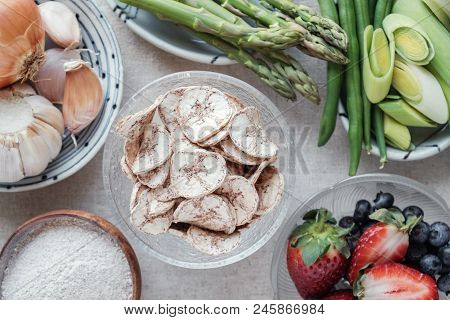 Variety Of Prebiotic Foods, Raw Green Banana, Asparagus, Onions, Garlic, Leeks, Berries And Green Be