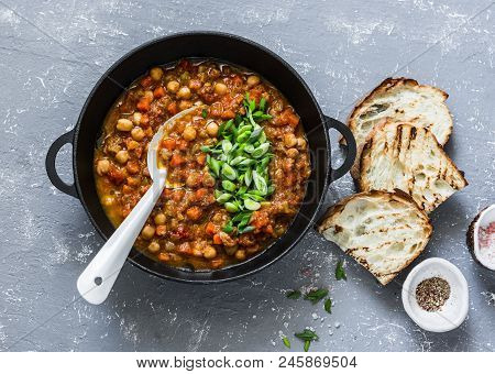 Vegetarian Mushrooms Chickpea Stew In A Iron Pan And Rustic Grilled Bread On A Gray Background, Top