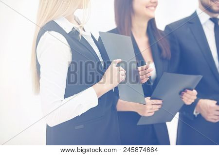 Closeup Of Business Team With Documents Preparing For The Beginning Of The Working Meeting