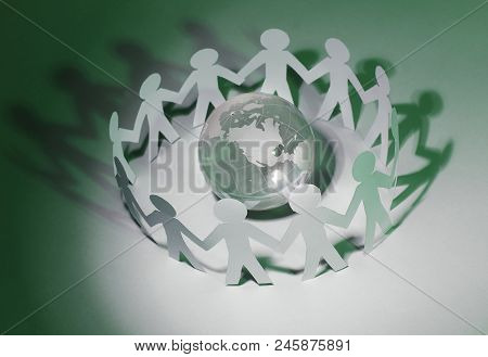 Business Background.team Paper Men Standing Around The Glass Globe.photo With Copy Space