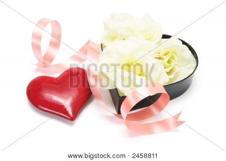 Red Heart Symbol And Gift Box Of Yellow Roses