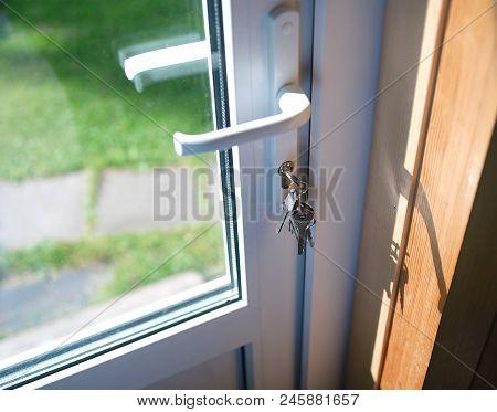 Keys In A Lock Of A Pvc Door, Indoor Cropped Shot