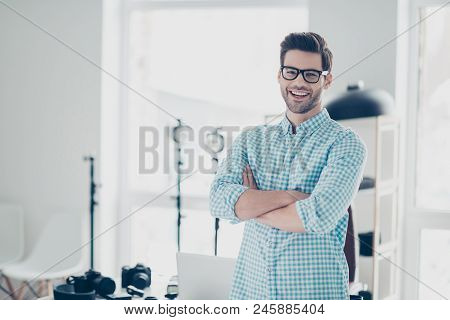 Portrait Of Attractive Cheerful Photo Camera Lover Standing In  Photo Studio With Crossed Arms, Laug
