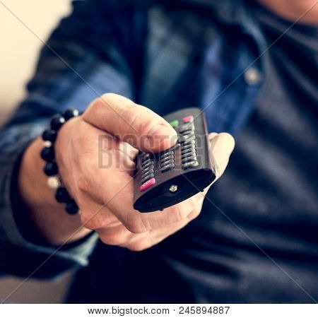 Hand carrying a remote controller