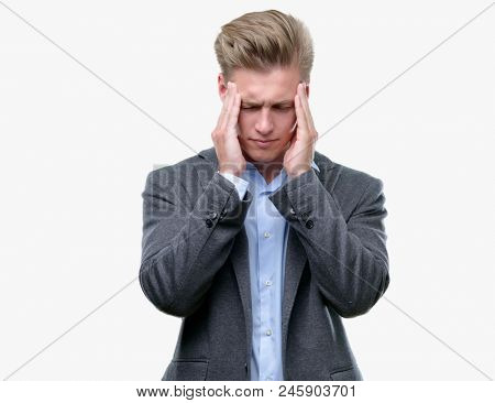 Young handsome blond business man with hand on head for pain in head because stress. Suffering migraine.