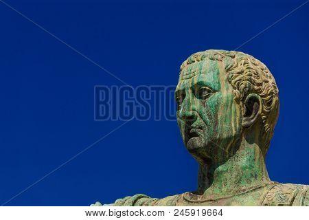 Caesar Augustus Nerva Emperor Of Ancient Rome Bronze Statue In Imperial Forum (with Copy Space)