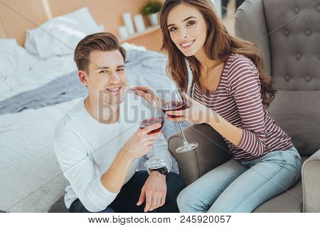 Romantic Evening. Happy Married Couple Looking At You While Having A Romantic Evening Together