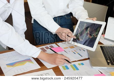 Business Team Investment Entrepreneur  Trading Stocks Online. Stock Brokers Looking At Graphs, Index
