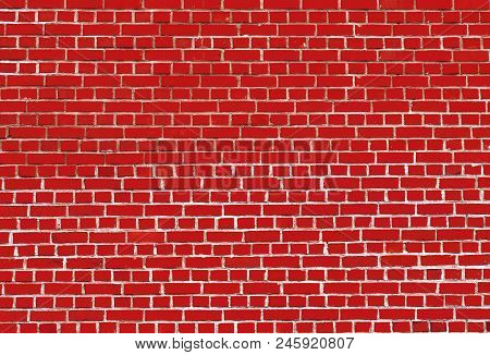 Close-up Of A Colorful Red Big Brick Wall.  View To A Red Stone Wall Made Of Bricks.  Natural Textur