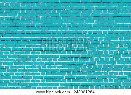 Close-up of a colorful Turquoise big Brick Wall.  View to a Blue Stone Wall made of Bricks.  Natural Textures and Backgrounds.