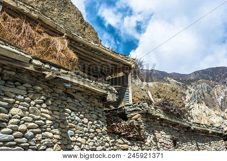 Hay Storage Shelter At The Top Of A Stone Structure In A Nepalese Village.