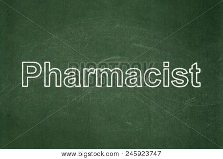 Medicine Concept: Text Pharmacist On Green Chalkboard Background