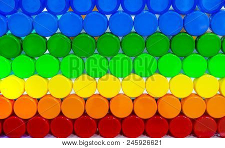 Colorful Plastic Bottle Cap Arrange With Beautiful Tone And Pattern. Blue, Green, Yellow, Orange, An