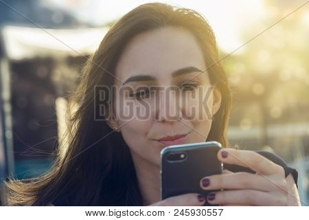 Worried Girl Looking At Cell Phone. Worried Girl Looking At Cell Phone Message. Upset Girl Reading M