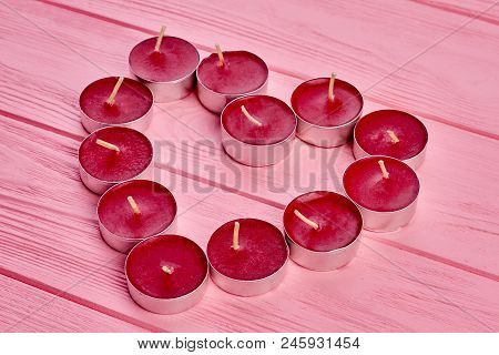 Tea Light Candles Forming The Shape Of A Heart. Idea For Valentines Day Celebration. Love Theme Conc