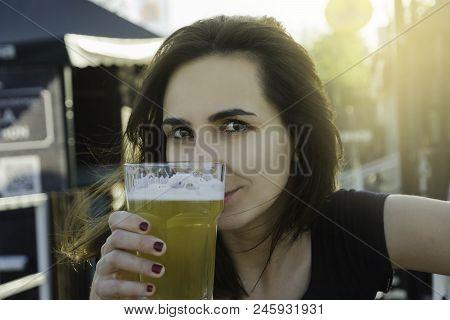 Beautiful Girl Having A Beer. Girl Having A Beer In Summertime. Drinking Beer In The Pub. Draft Beer