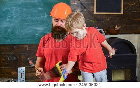 Boy, Child Cheerful Playing With Toy Saw, Learning Use Tools With Dad. Father, Parent With Beard In