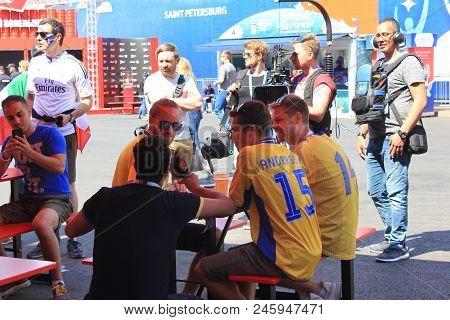St. Petersburg, Russia - June 18, 2018: Journalist Interviewing Swedish Fans At Fifa World Cup Fan Z