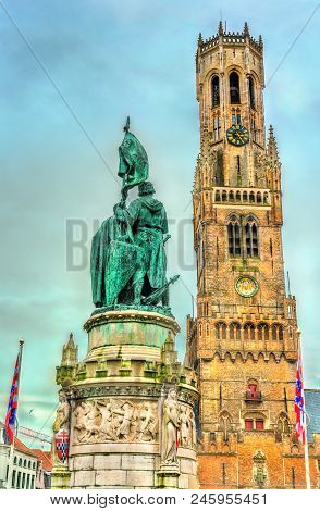 Statue Of Jan Breydel And Pieter De Coninck And The Belfry Of Bruges, A Medieval Bell Tower In West